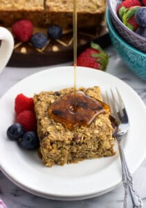 Healthy baked oatmeal bars are naturally-sweetened and maple flavored for a delicious and filling breakfast recipe. Easy to customize with fresh or dried fruit and nuts, these bars are great for snacks, too!