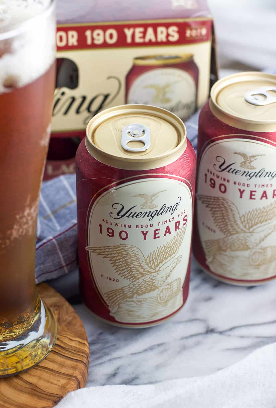 A close-up of Yuengling cans on a marble board
