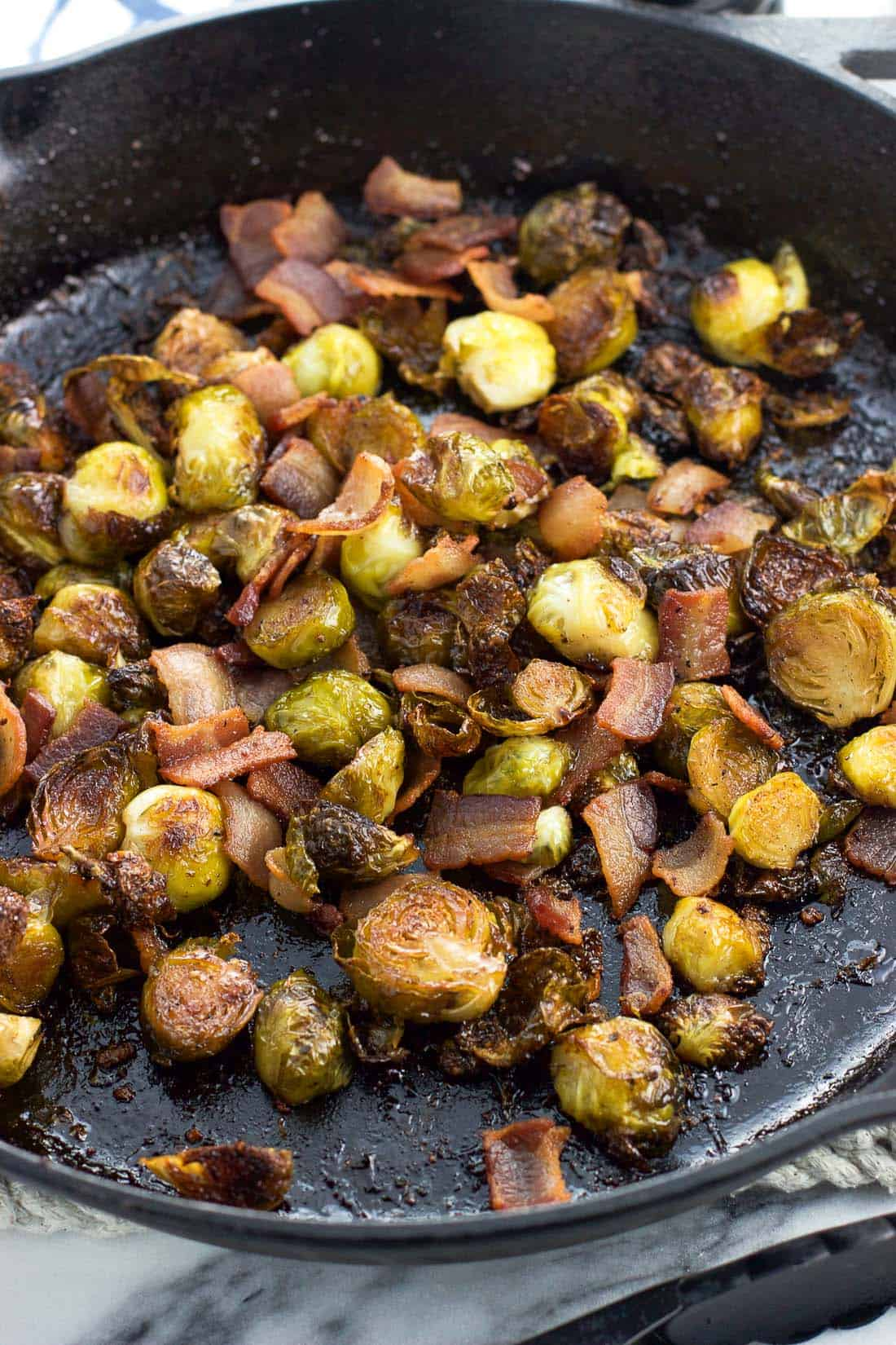 Maple bacon brussels sprouts in a cast iron skillet after roasting