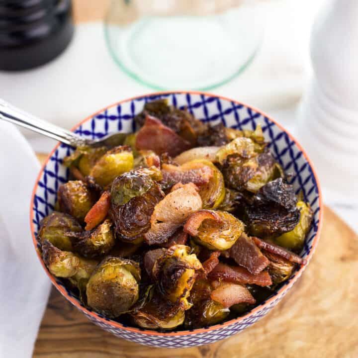 Maple bacon roasted brussels sprouts are made all in one pan for a delicious side dish that cuts down on dishes. This roasted brussels sprouts recipe features easy kitchen staples and pairs well with chicken, pork, and more!