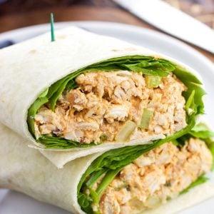 A chicken salad wrap sandwich on a plate