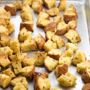 Baked croutons on a metal baking sheet