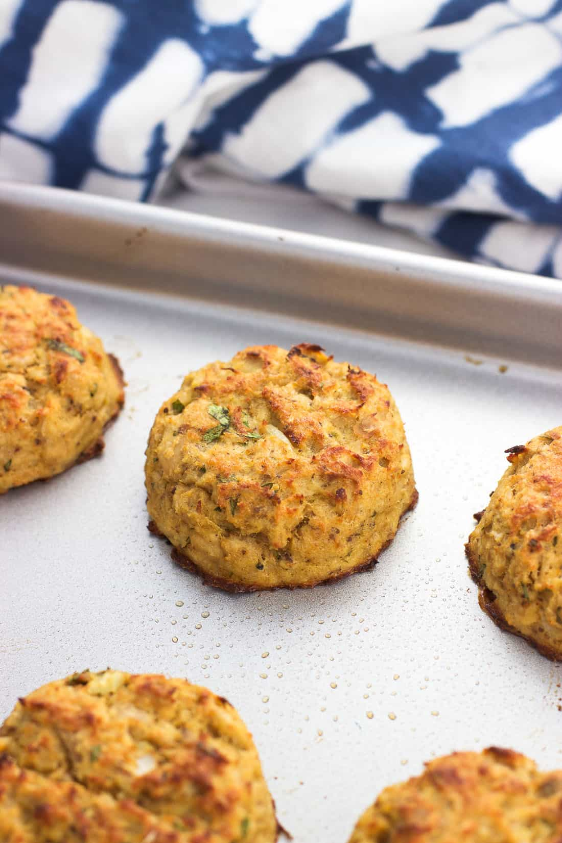 A baked and broiled tuna cake on a baking sheet
