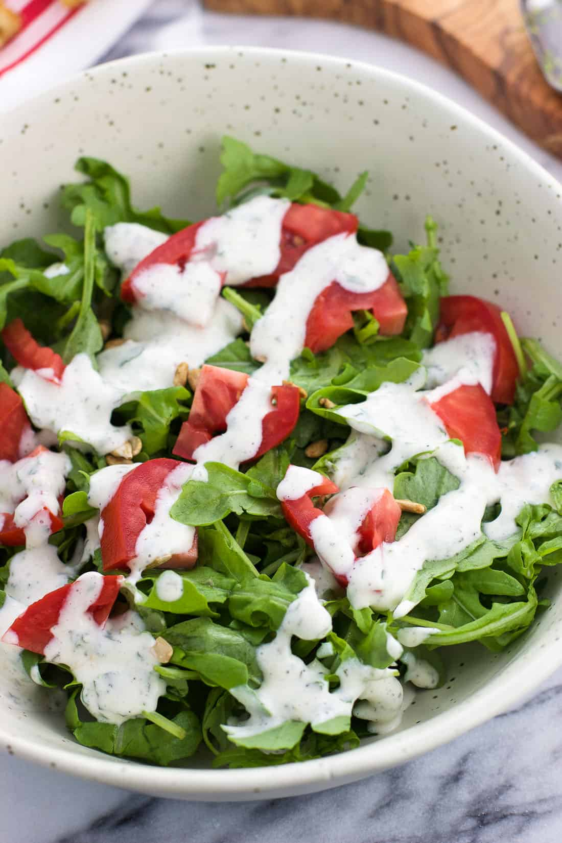 Salad in a bowl with a healthy cilantro lime ranch dressing drizzle