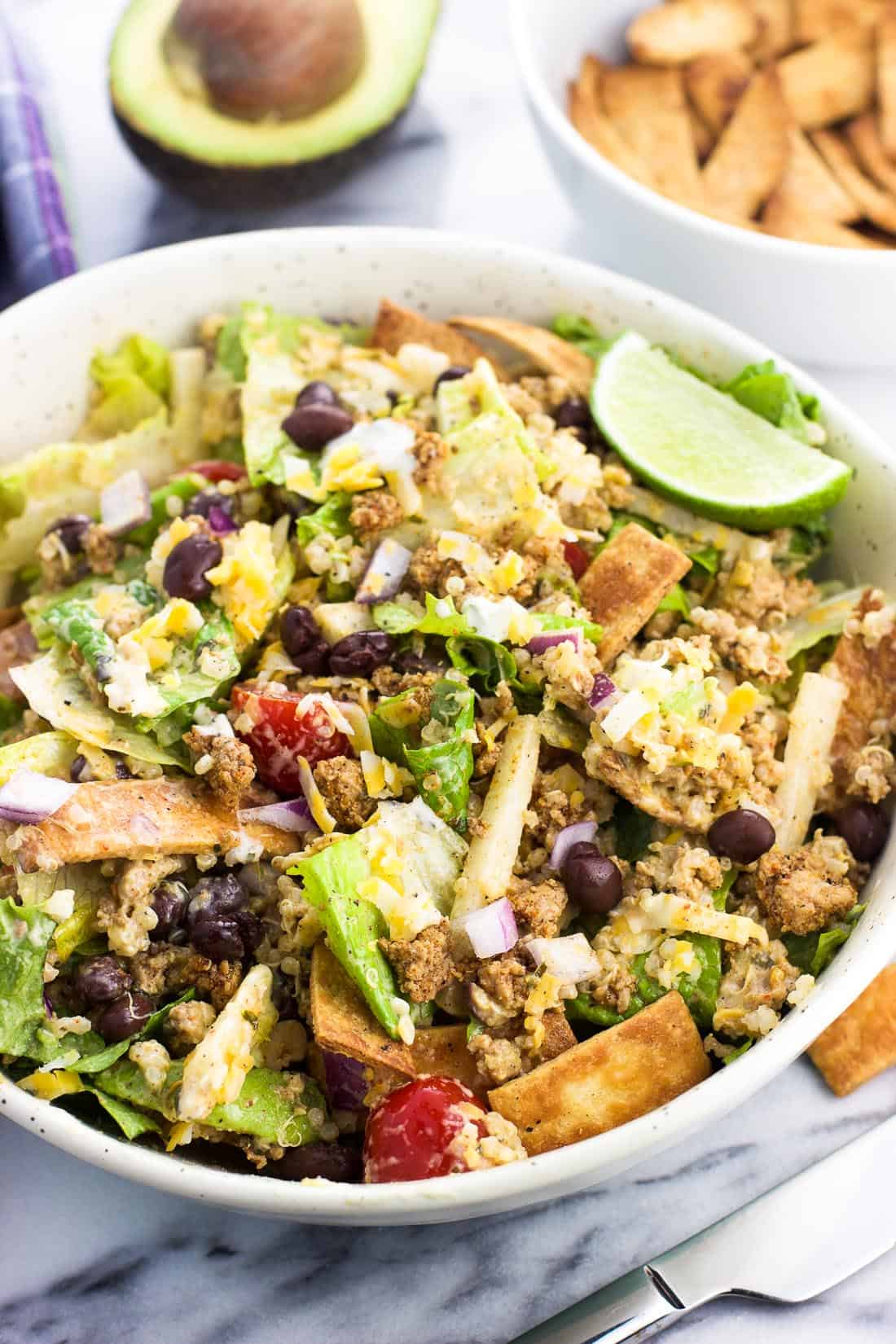 All of the turkey taco salad ingredients mixed together in a bowl for serving