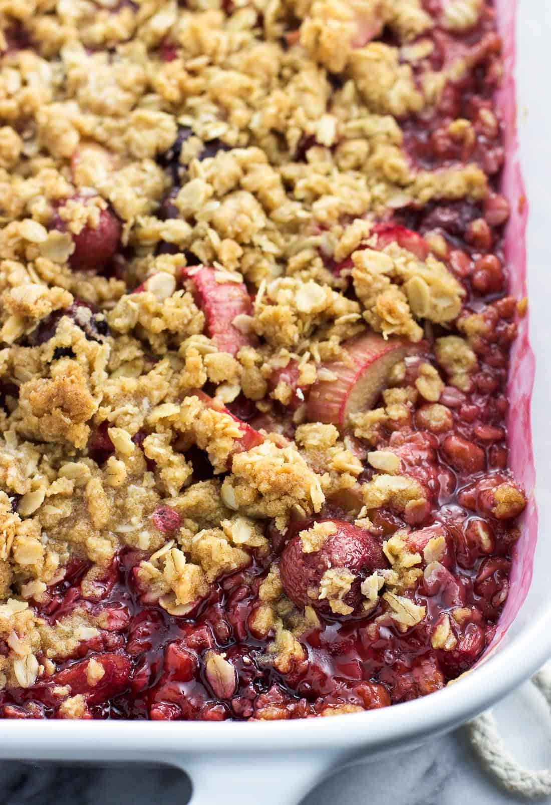 Baked cherry rhubarb crisp in a baking dish