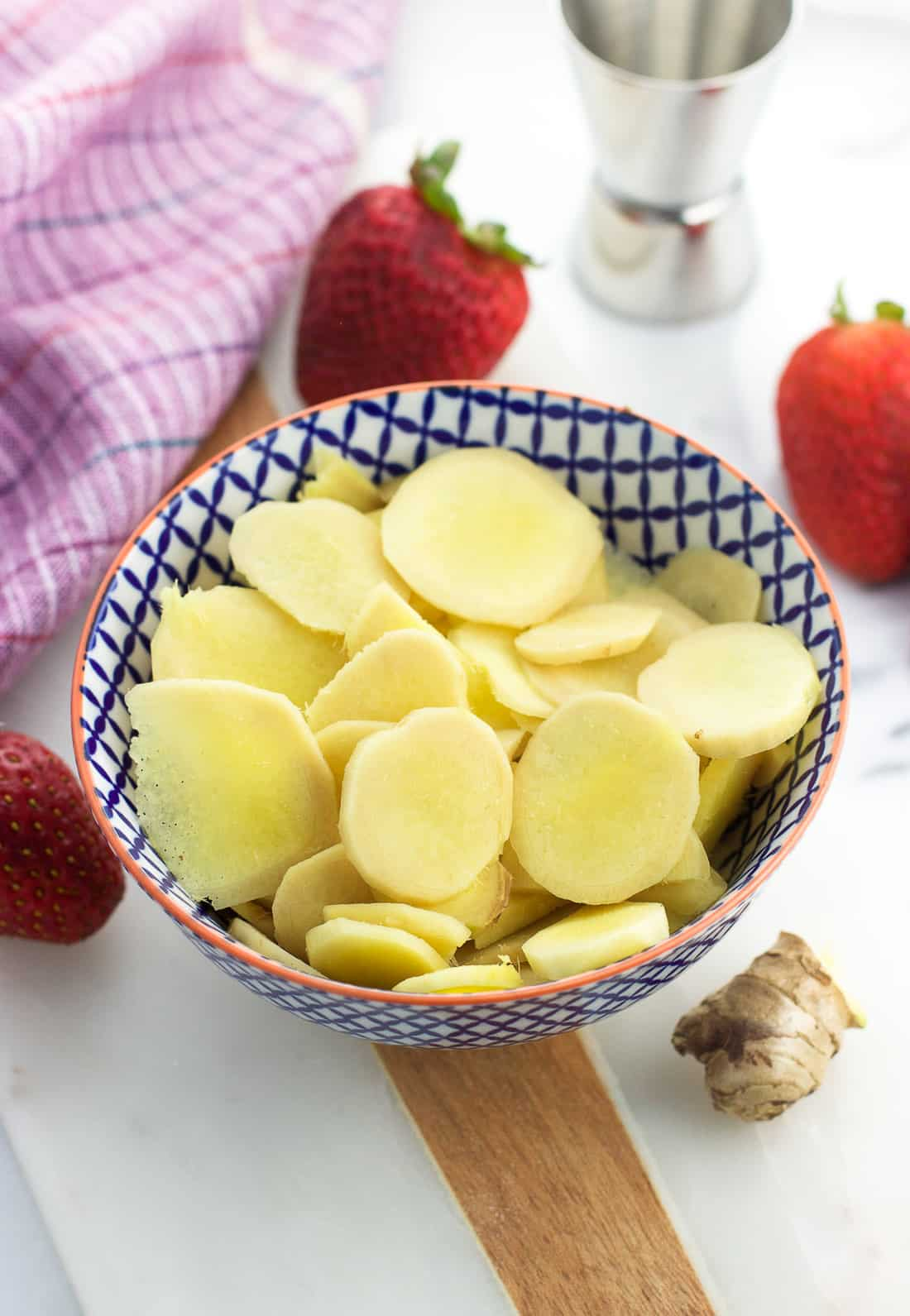 Fresh ginger slices in a small bowl
