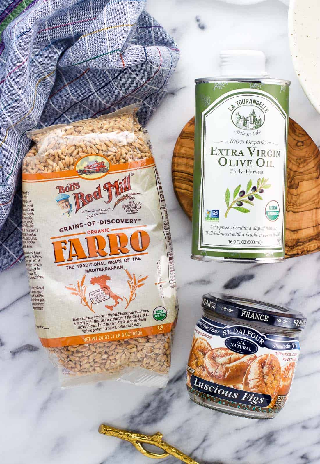 An overhead shot of farro, olive oil, and figs from iHerb