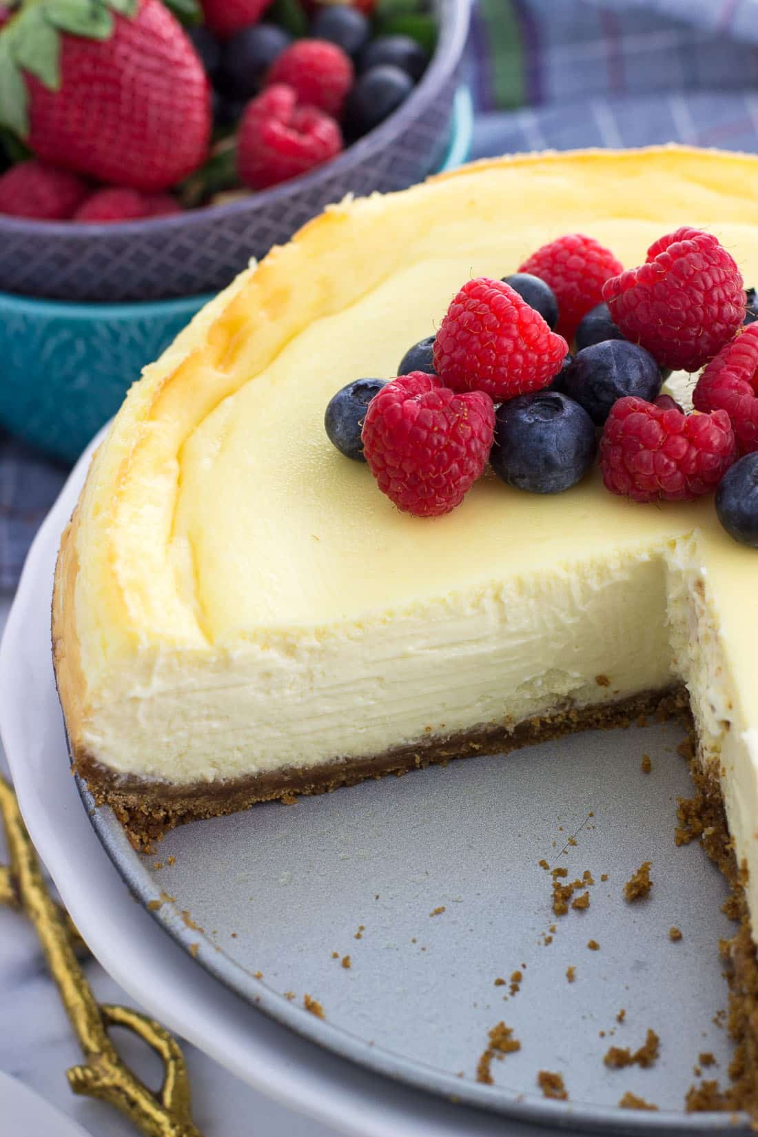 Cheesecake on the base of a springform pan with slices cut out