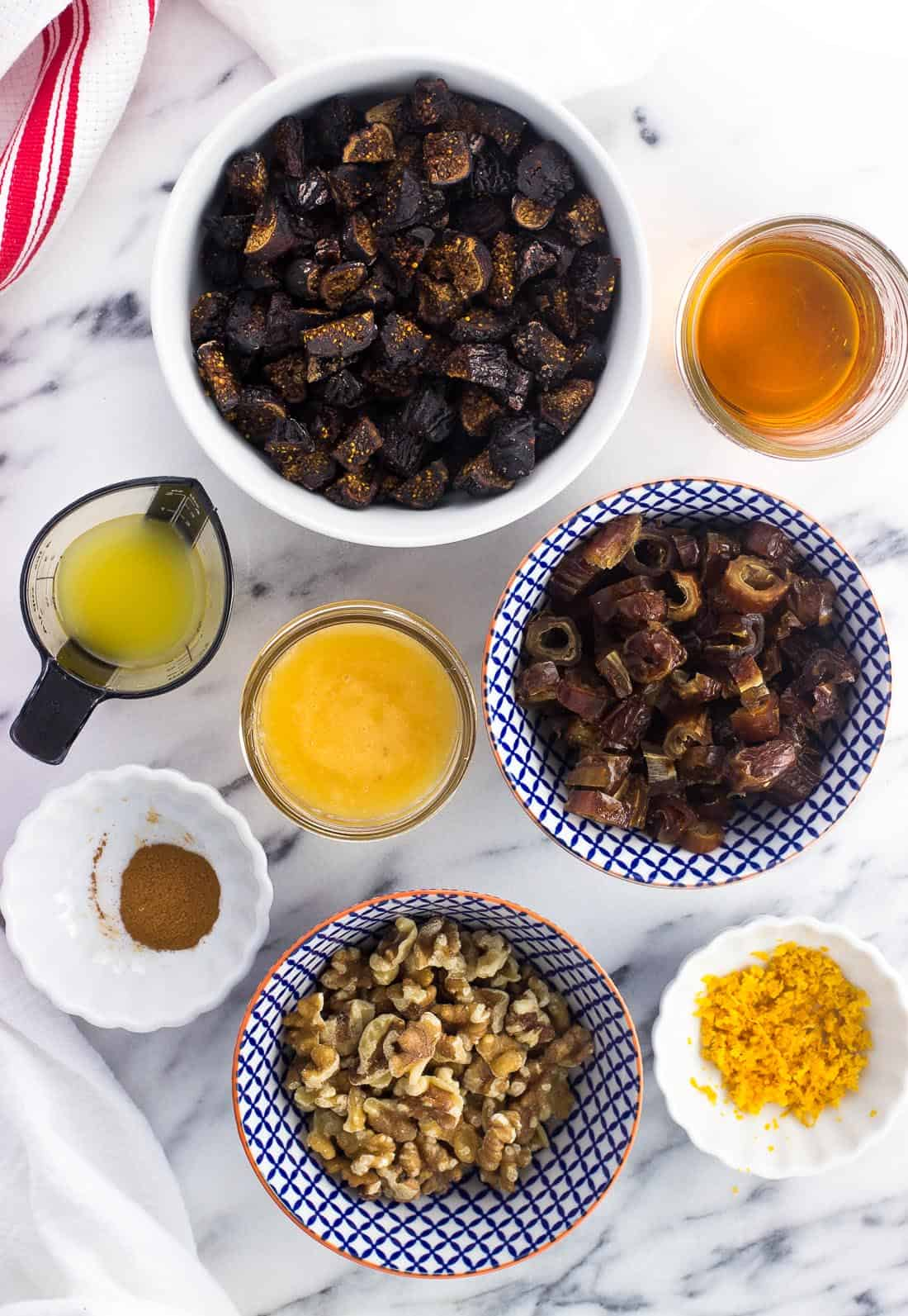 Cucidati ingredients in separate bowls on a marble board