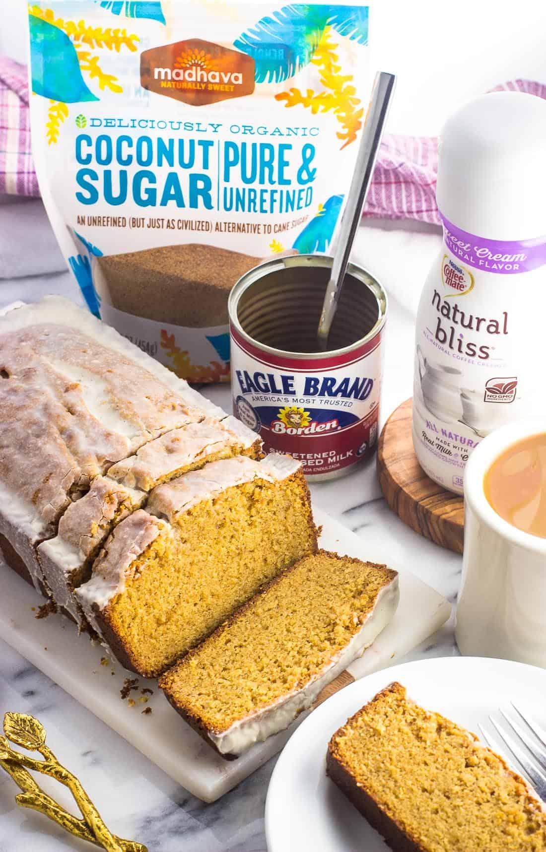 Sliced and glazed pound cake served alongside a cup of coffee