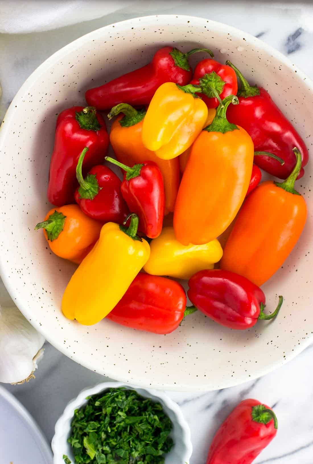 A close-up picture of a bowl of mini sweet peppers