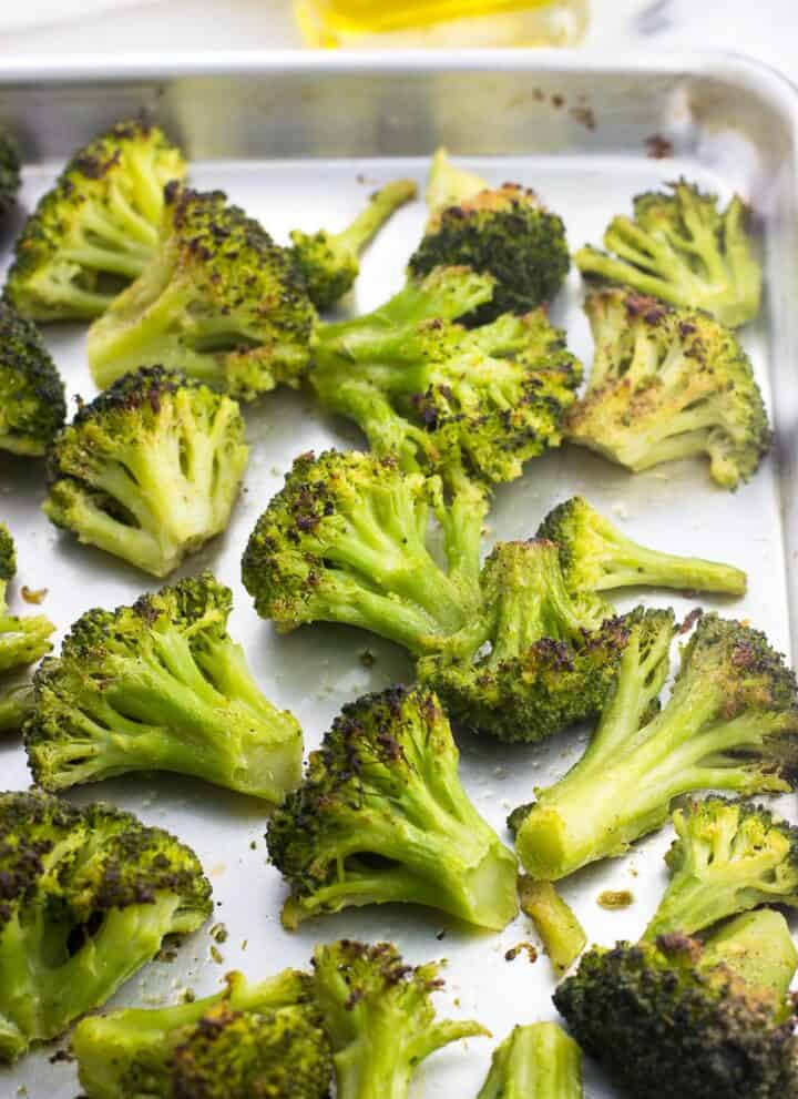 Roasted broccoli on a sheet pan after being in the oven