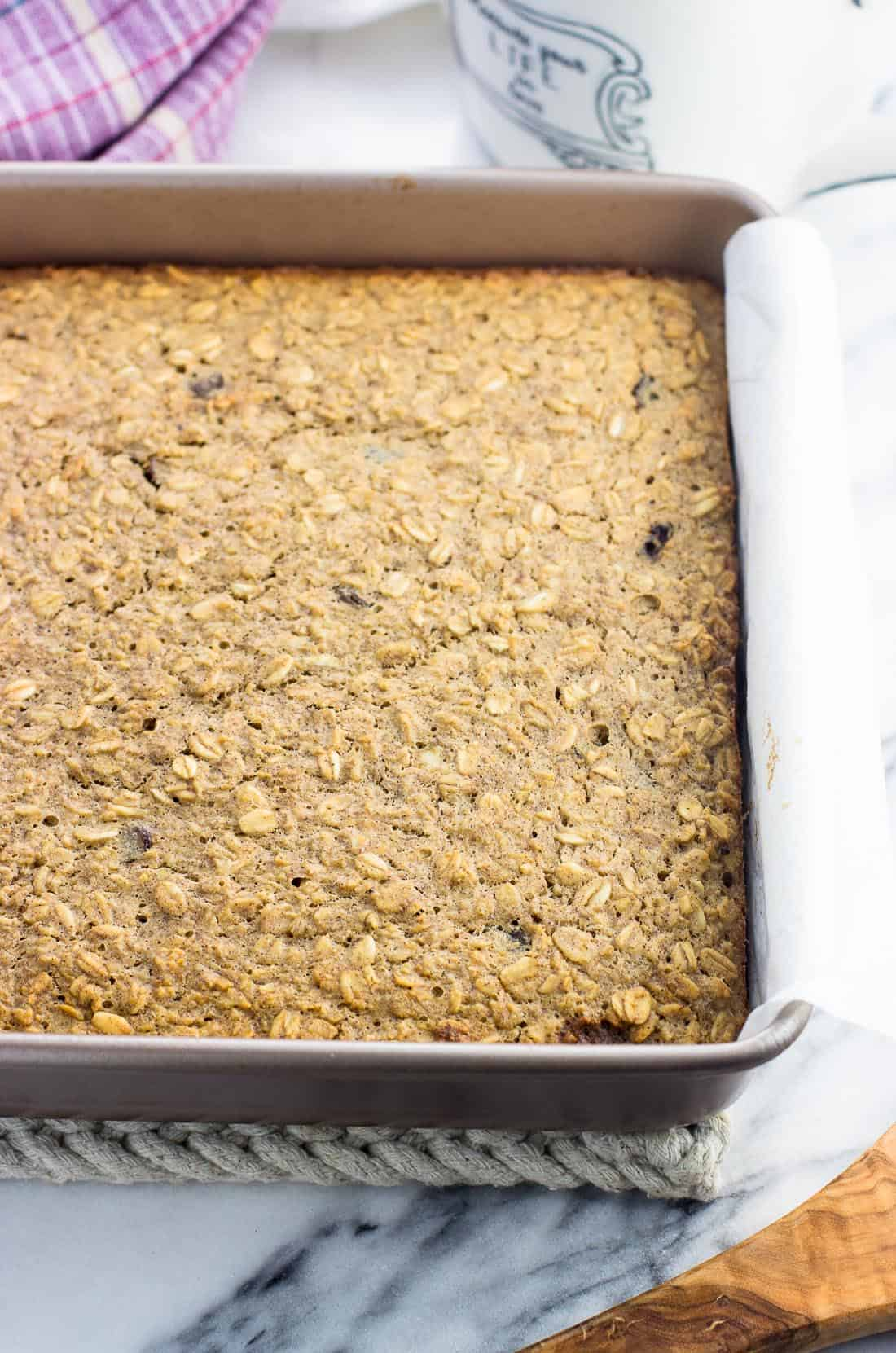 A pan of peanut butter baked oatmeal before being sliced into squares