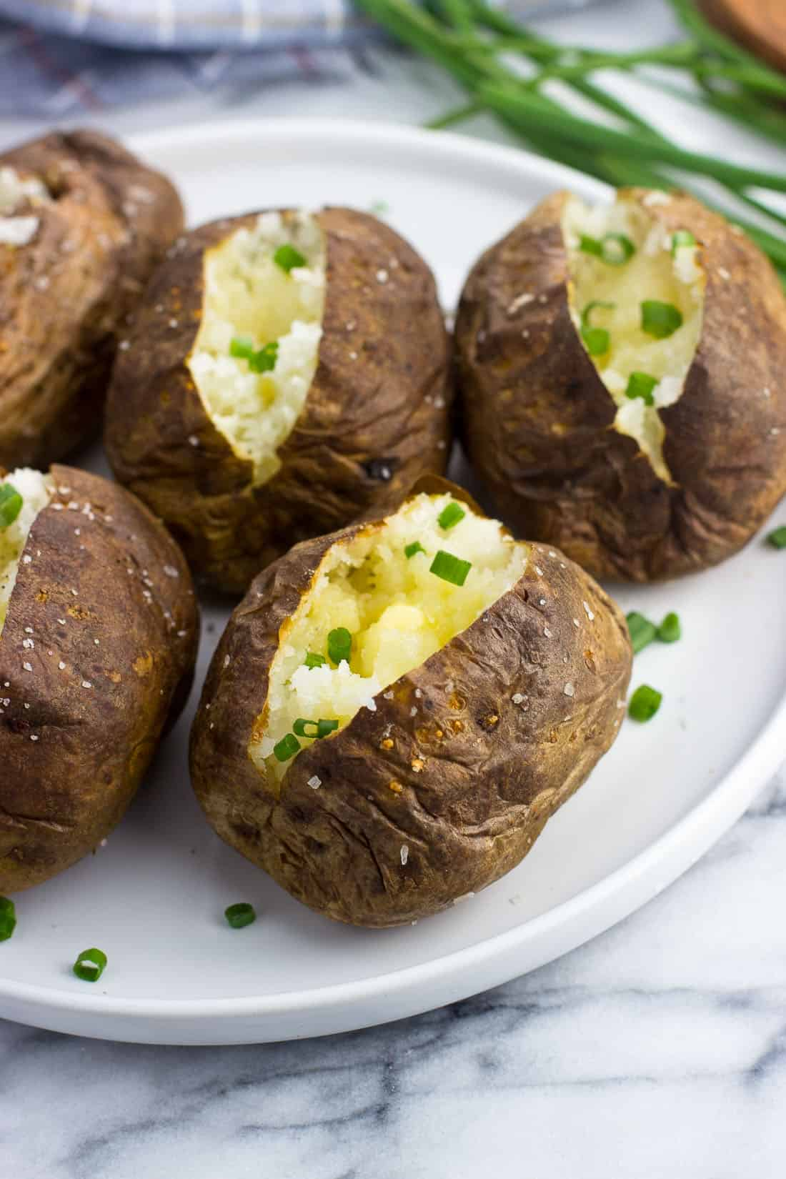 A close-up of an air fryer baked potato on a plate