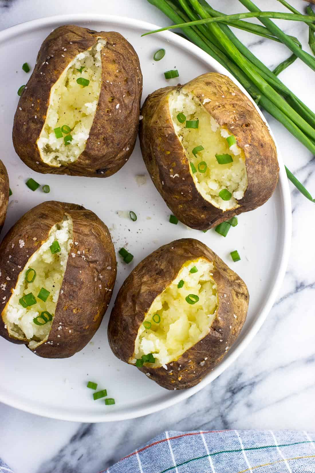 An overhead picture of air fryer baked potatoes on a plate