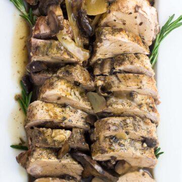 An overhead shot of sliced pork tenderloin on a serving plate
