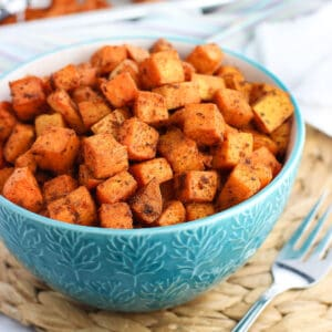 A bowl of cubed and roasted sweet potatoes