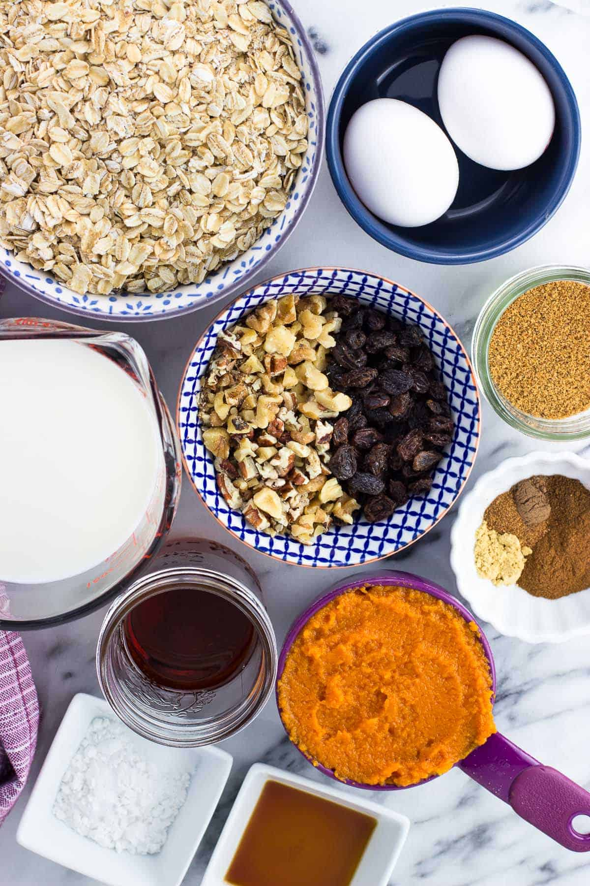 All recipe ingredients in separate jars, bowls, and measuring cups on a marble board