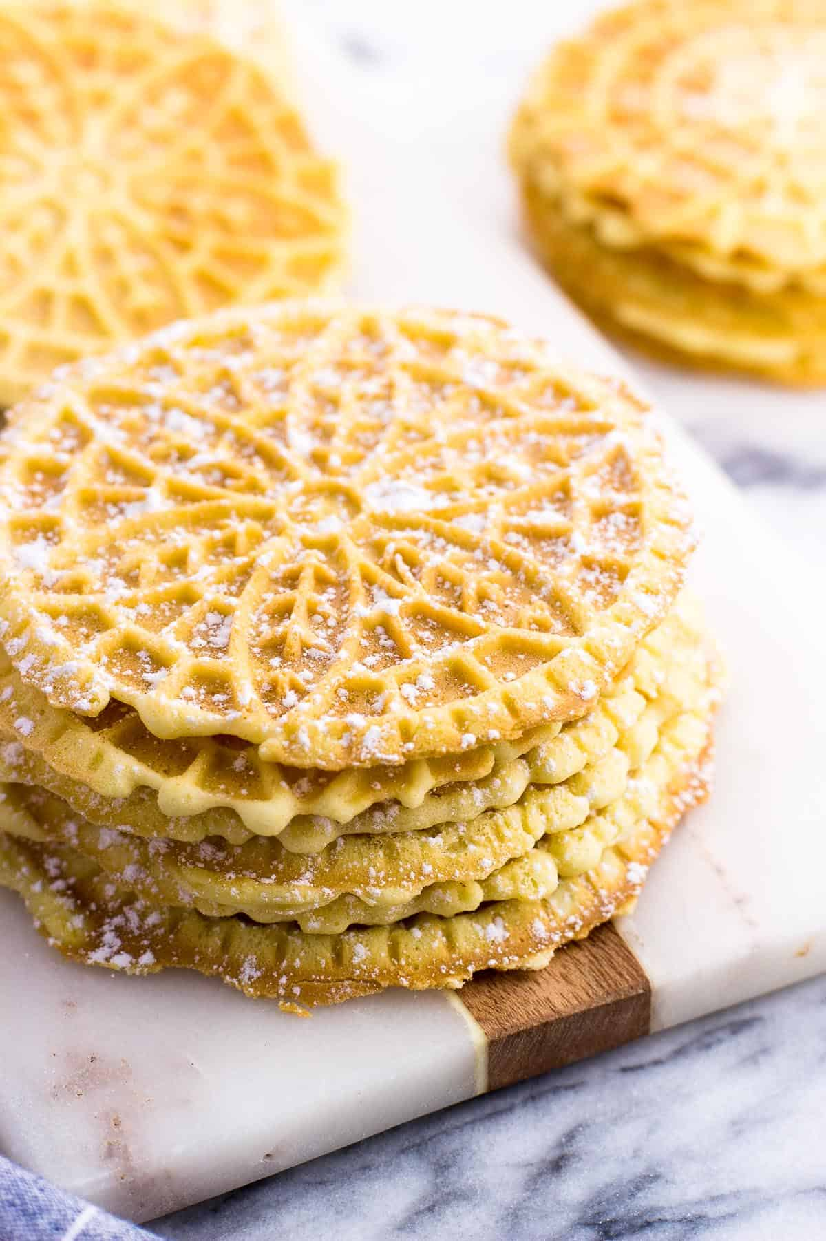 A stack of pizzelle on a marble board
