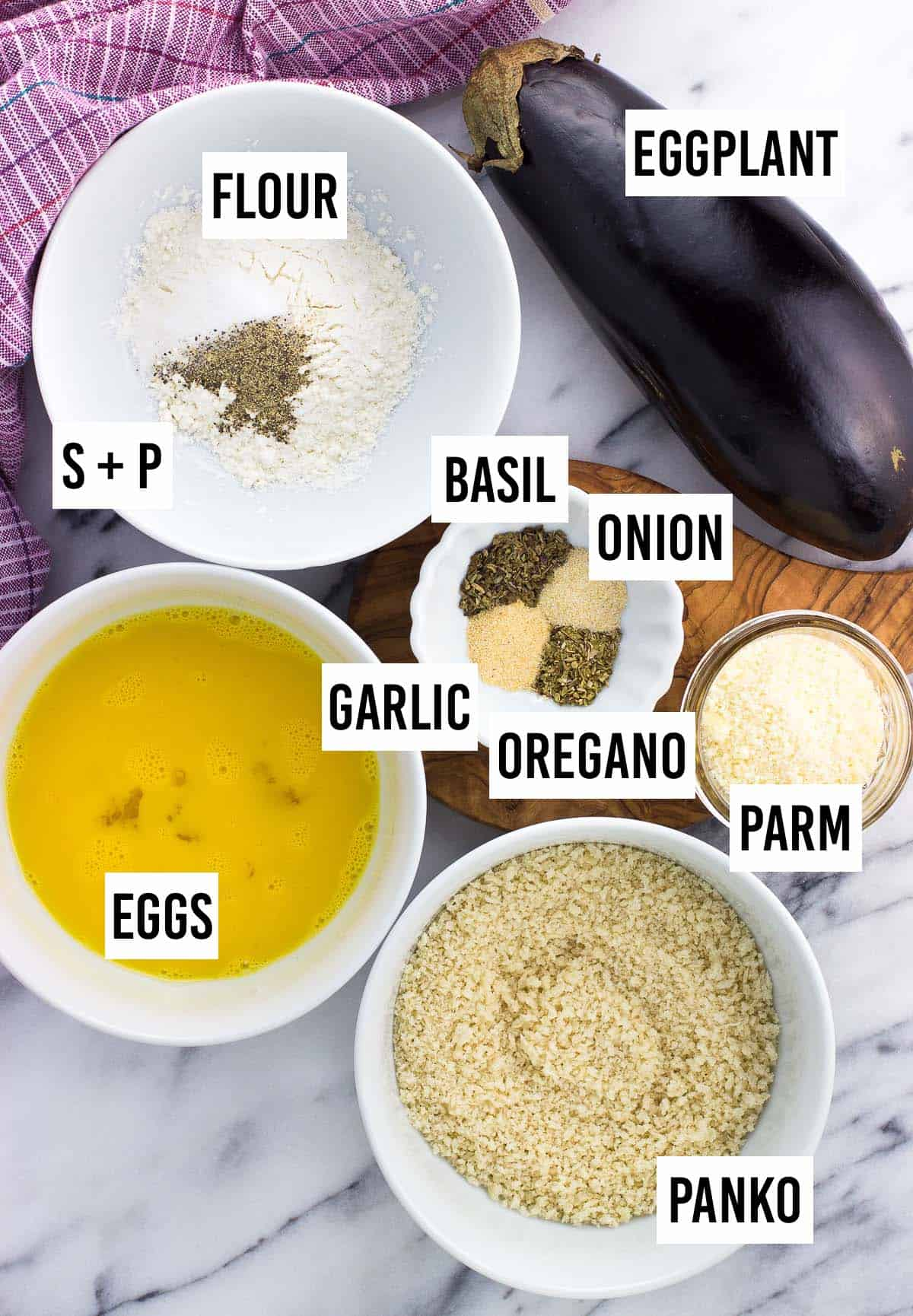 Recipe ingredients in separate bowls on a board.