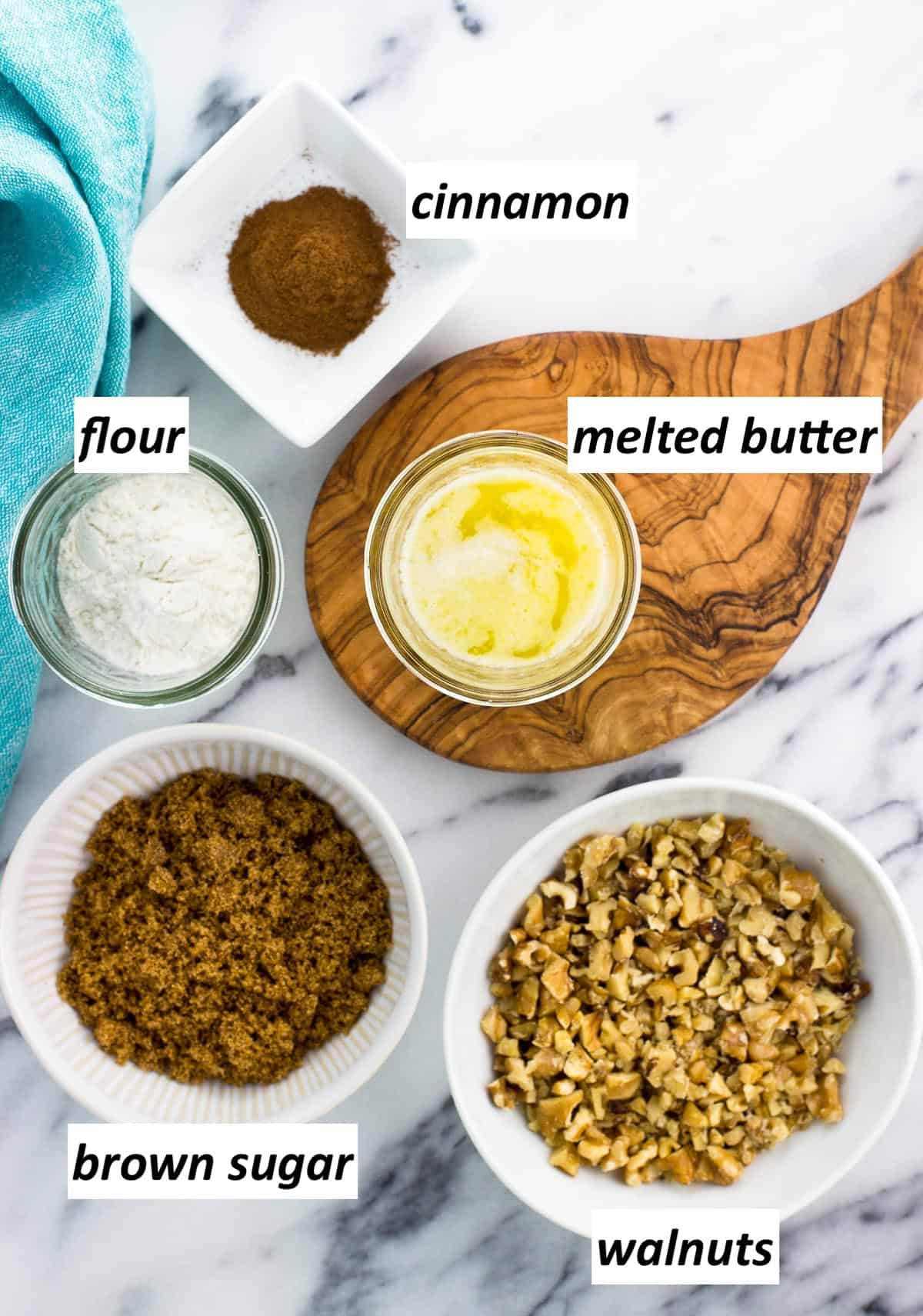 Labeled streusel ingredients in separate bowls.