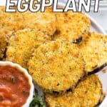 Breaded eggplant rounds on a plate with a small bowl of marinara sauce.