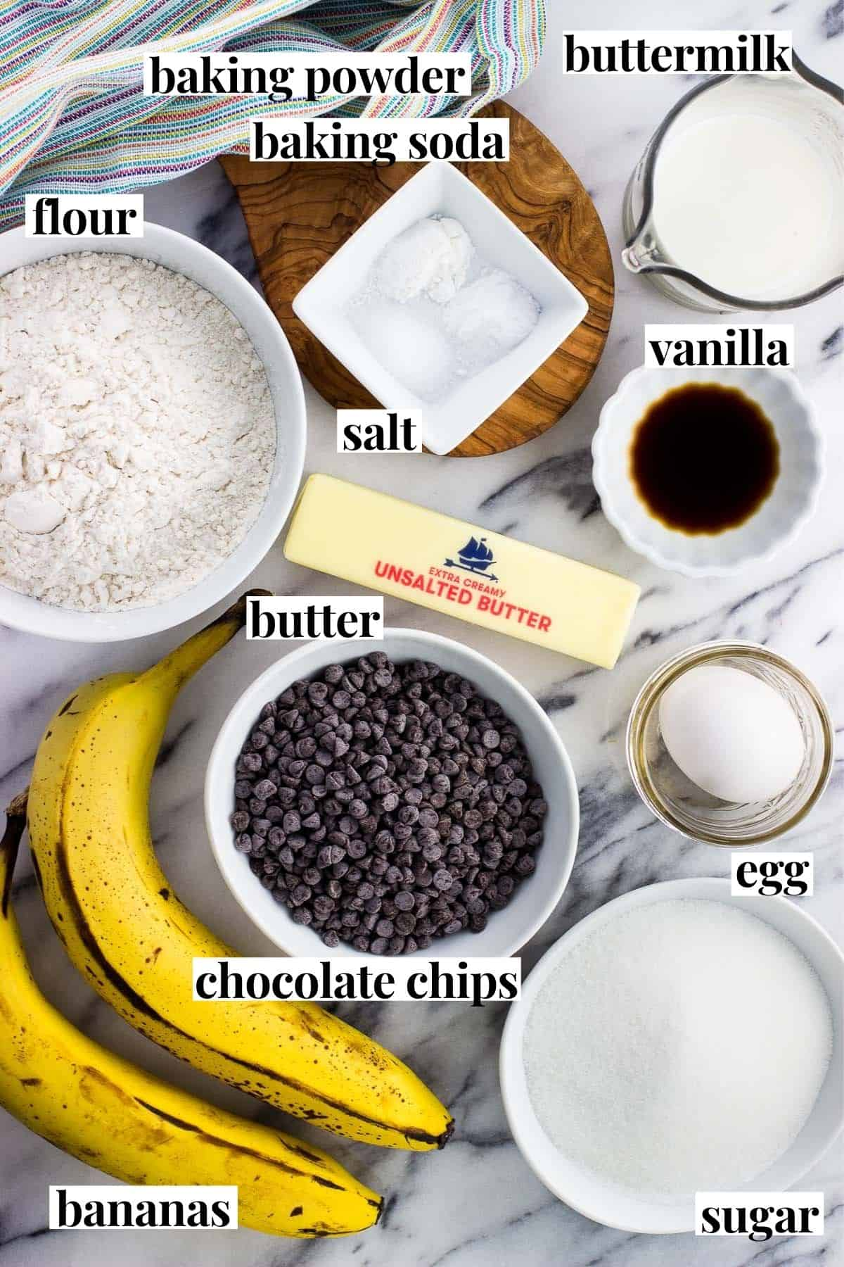 Labeled crumb cake ingredients in separate bowls.