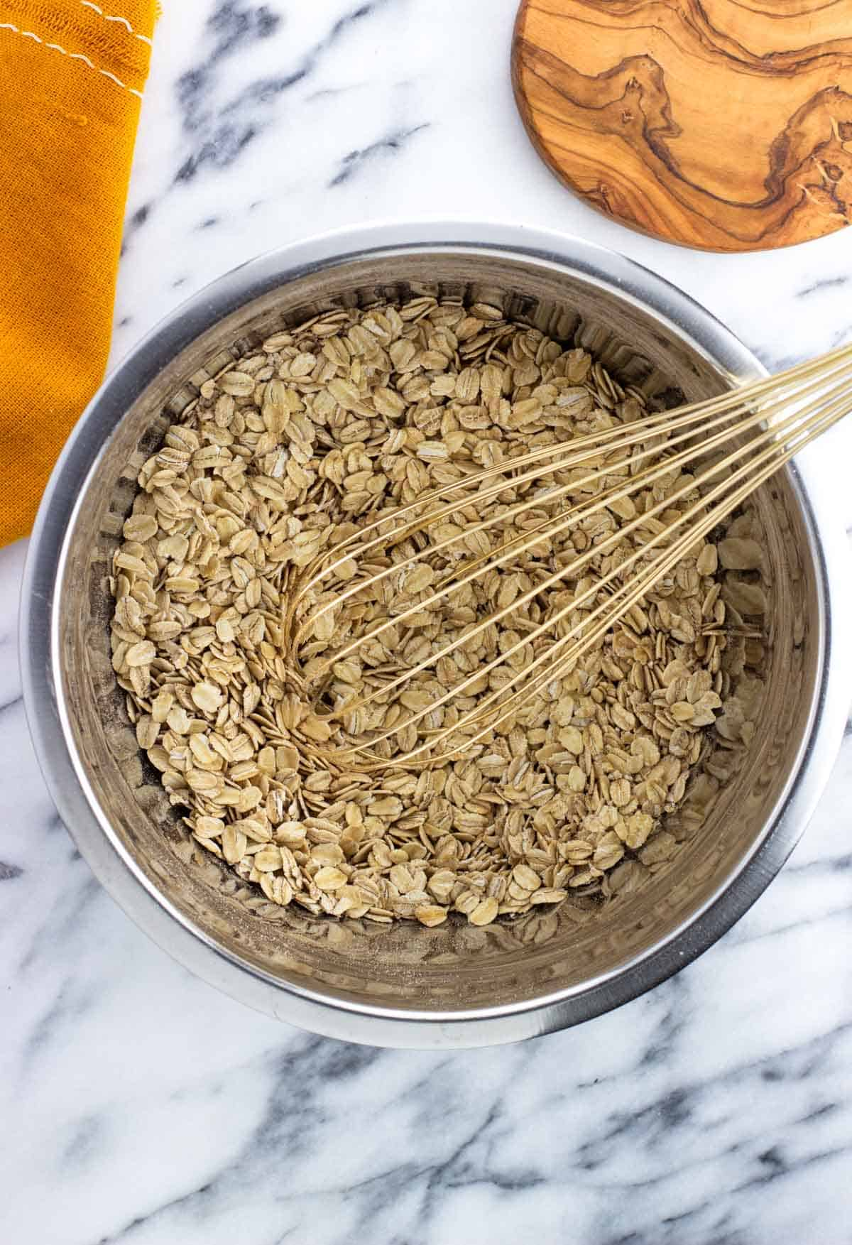 Dry ingredients combined in a bowl with a whisk.