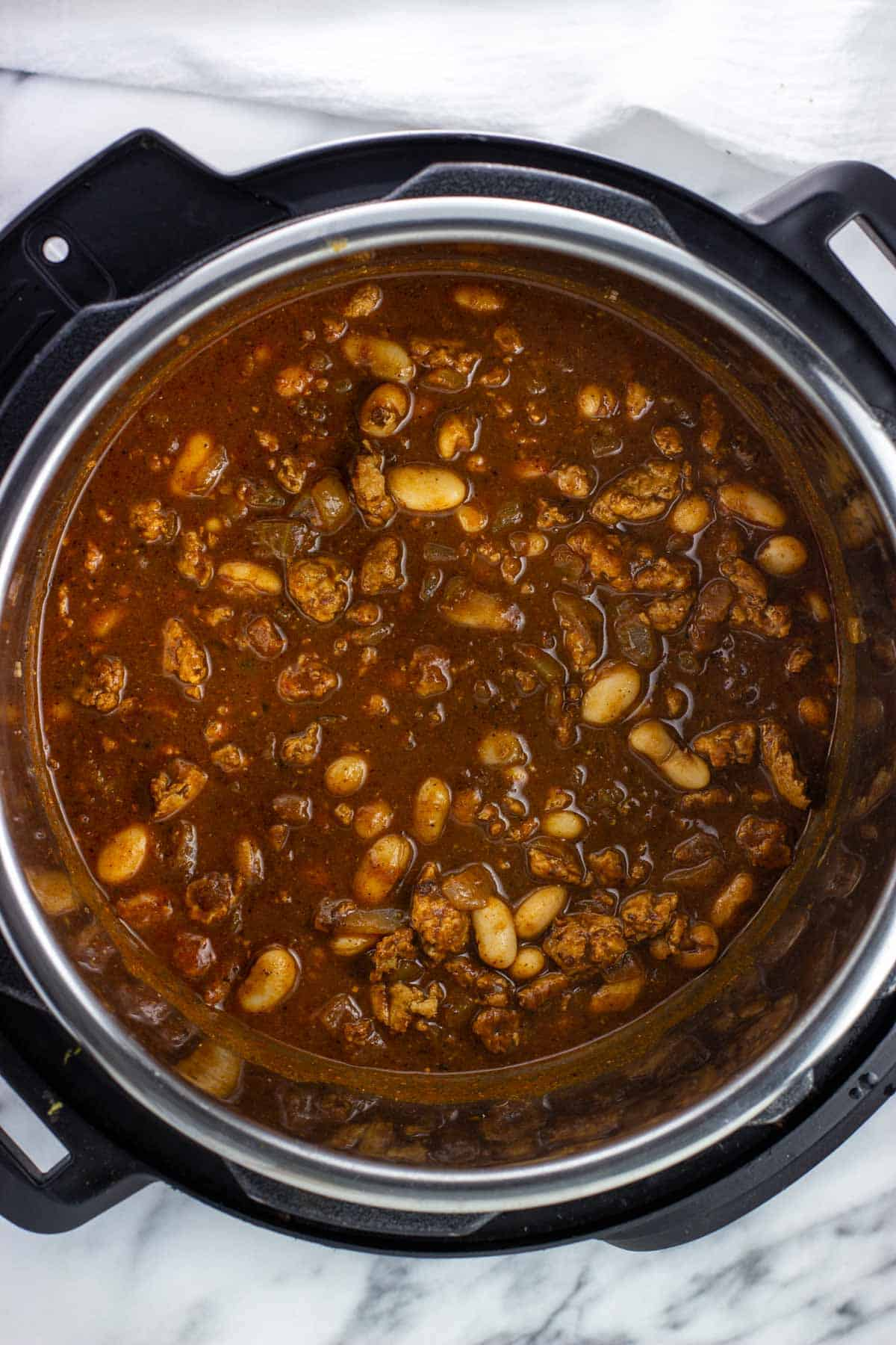 Pumpkin, beans, and Worcestershire stirred into the chili.