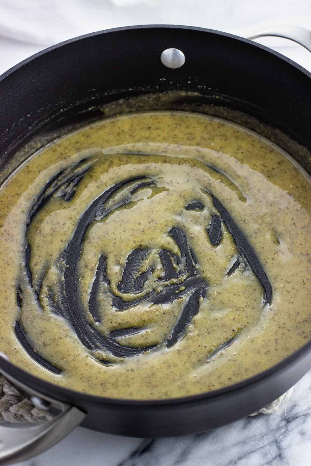 Dried seasonings whisked into the butter and flour in a pan.