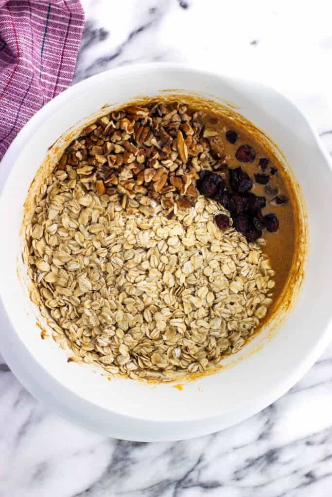 Oats, nuts, and dried fruit added to the pumpkin baked oatmeal mixture.