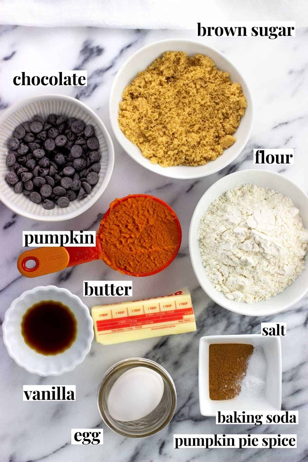 Labeled pumpkin layer ingredients on a marble board.